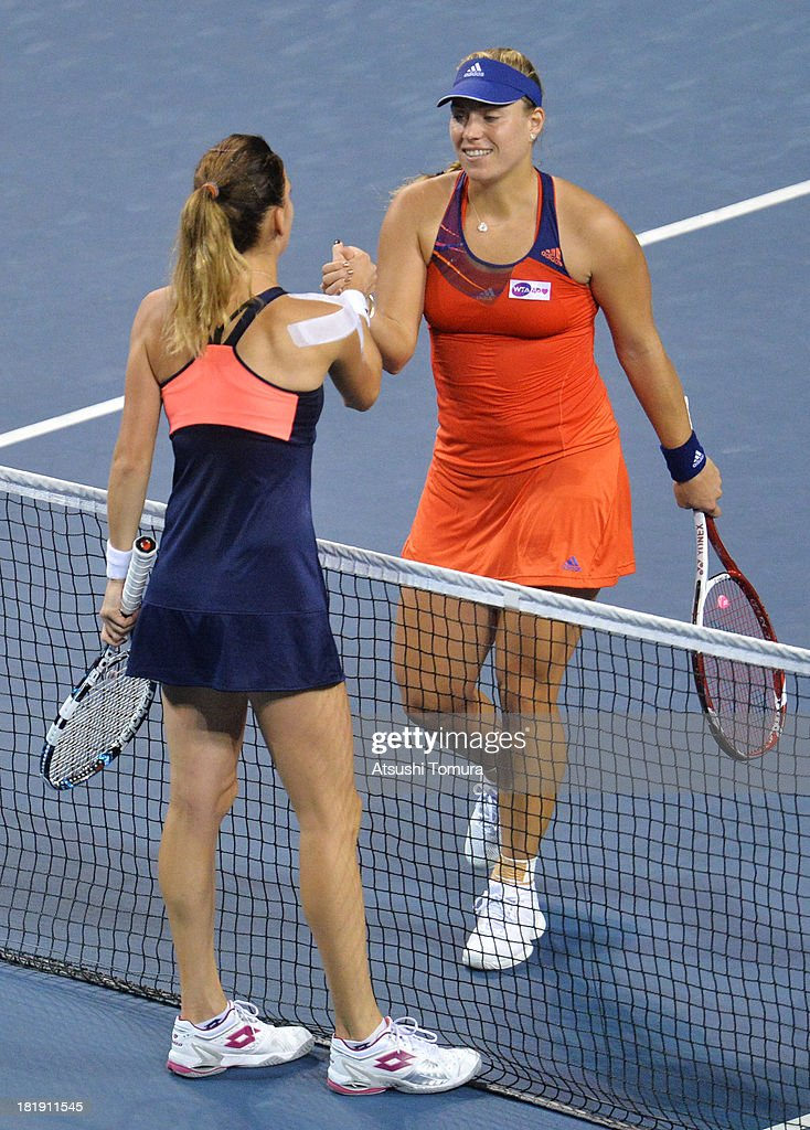 Angelique Kerber of Germany (R) shakes hands with Agnieszka Radwanska of Poland after winning her women's singles quarter final match against during day five of the Toray Pan Pacific Open at Ariake Colosseum on September 26, 2013 in Tokyo, Japan.