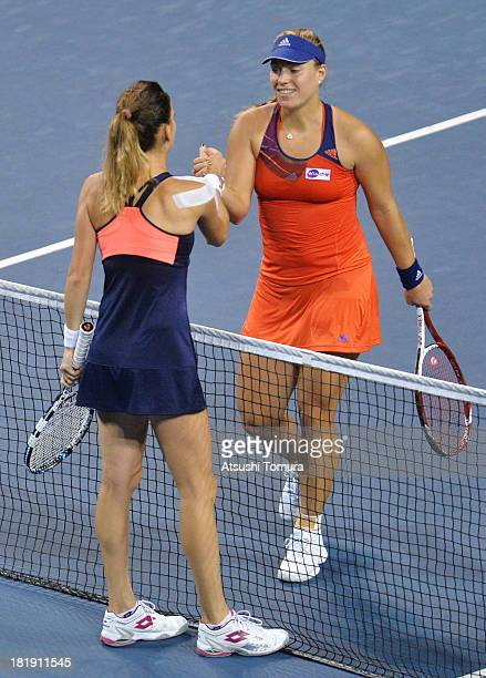 Angelique Kerber of Germany shakes hands with Agnieszka Radwanska of Poland after winning her women's singles quarter final match against during day...