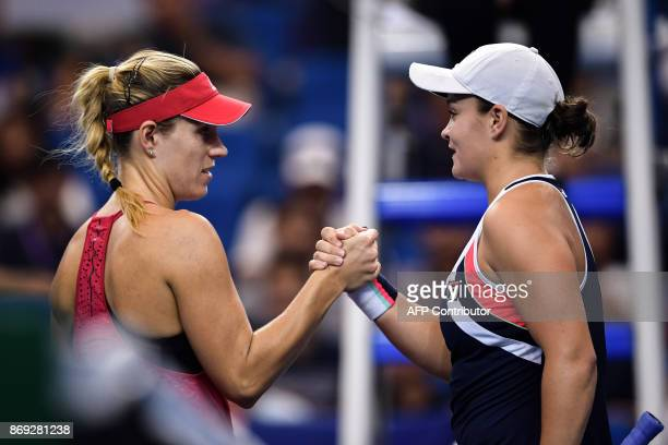 Angelique Kerber of Germany shakes hands with Ashleigh Barty of Australia after their women's singles match at the Zhuhai Elite Trophy tennis...