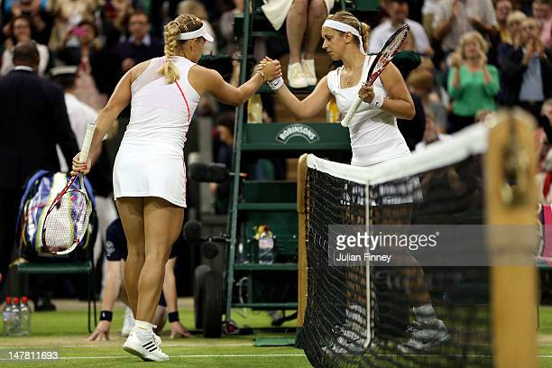 Angelique Kerber of Germany shakes hands with Sabine Lisicki of Germany after defeating her in their Ladies' Singles quarterfinal match on day eight...