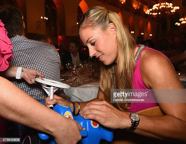 Angelique Kerber of Germany signs a Bobby Car during Day Three of the Nuernberger Versicherungscup 2015 on May 18 2015 in Nuremberg Germany
