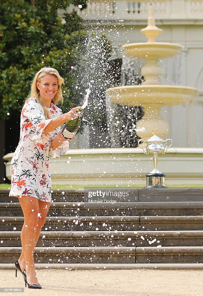 Angelique Kerber of Germany sprays champagne with the Daphne Akhurst Memorial Cup during a photocall at Government House after winning the 2016 Australian Open on January 31, 2016 in Melbourne, Australia.