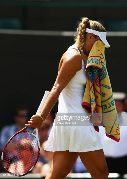Angelique Kerber of Germany stands dejected during her Ladies' Singles quarterfinal match against Eugenie Bouchard of Canada on day nine of the...