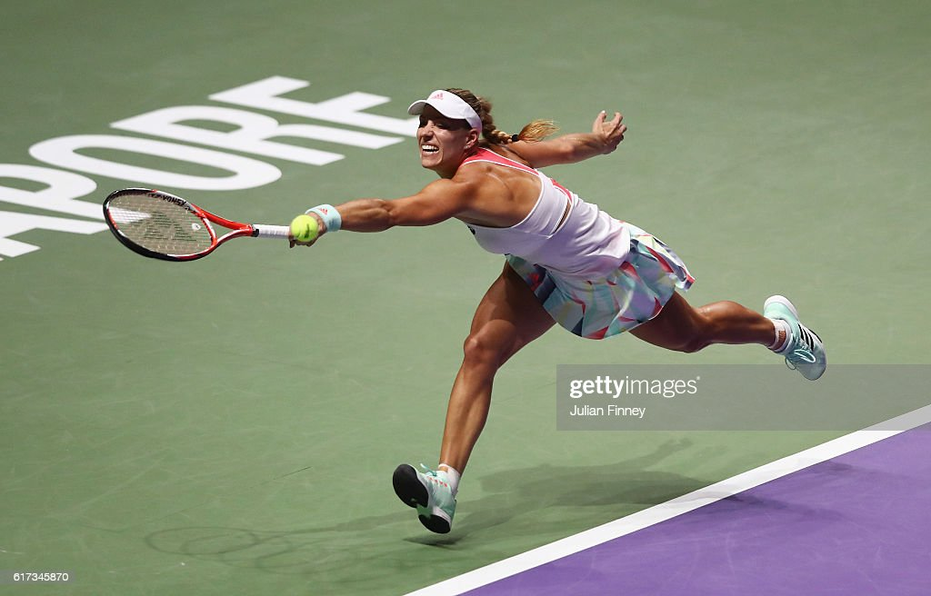 Angelique Kerber of Germany stretches for a backhand in her singles match against Dominika Cibulkova of Slovakia during day 1 of the BNP Paribas WTA Finals Singapore at Singapore Sports Hub on October 23, 2016 in Singapore.