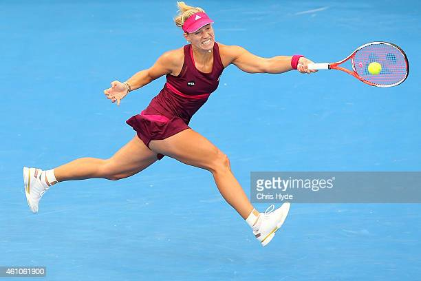 Angelique Kerber of Germany stretches for a forehand during day three of the 2015 Brisbane International at Pat Rafter Arena on January 6 2015 in...