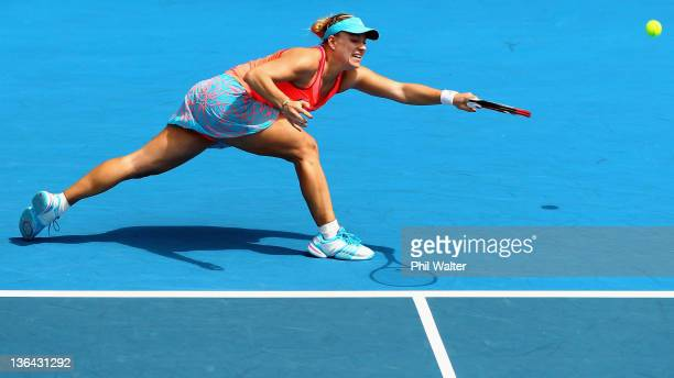 Angelique Kerber of Germany stretches for a forehand in her game against Sabine Lisicki of Germany during day four of the 2012 ASB Classic at ASB...