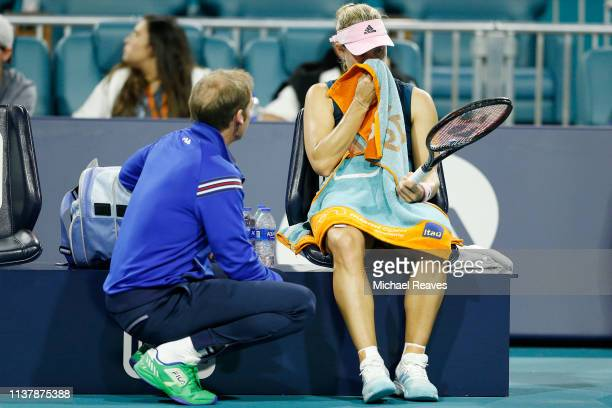 Angelique Kerber of Germany talks with her coach Rainer Schuttler during her match against Bianca Andreescu of Canada during Day 6 of the Miami Open...