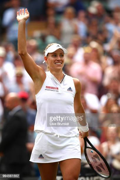 Angelique Kerber of Germany thanks the crowd after winning her Ladies' Singles fourth round match against Belinda Bencic of Switzerland on day seven...
