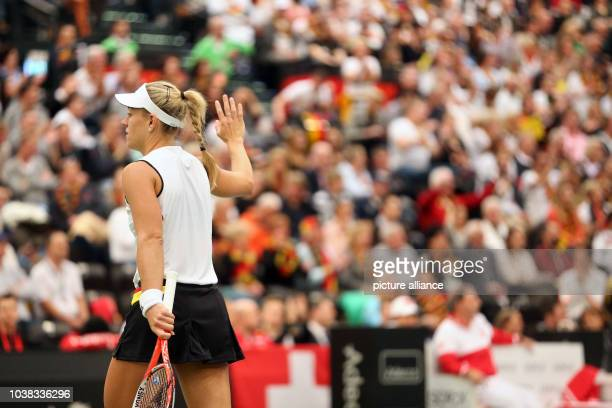Angelique Kerber of Germany walk of the tennis court after the match against Belinda Bencic of Switzerland at the Fed Cup tennis quarterfinal in...