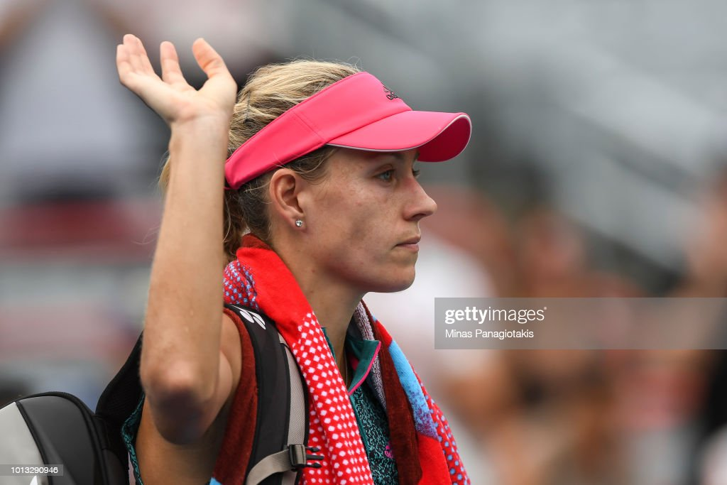 Angelique Kerber of Germany walks off the court after losing in straight sets 6-4, 6-1 to Alize Cornet of France during day three of the Rogers Cup at IGA Stadium on August 8, 2018 in Montreal, Quebec, Canada.