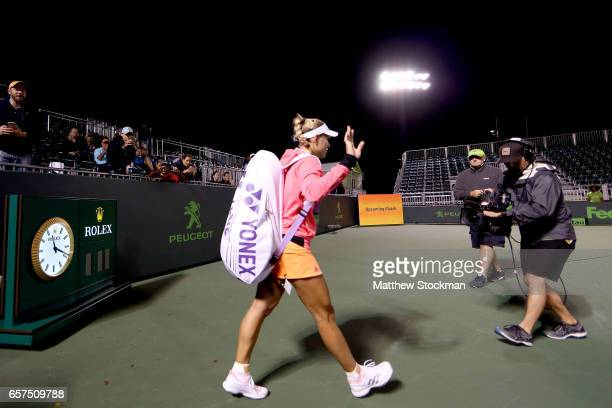 Angelique Kerber of Germany walks on to the grandstand court for her match against YingYing Duan of China during the Miami Open at the Crandon Park...