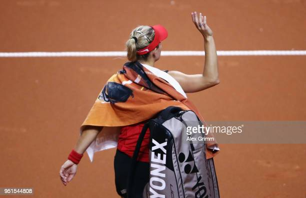Angelique Kerber of Germany waves to the fans after retiring from her match against Anett Kontaveit of Estonia during day 4 of the Porsche Tennis...