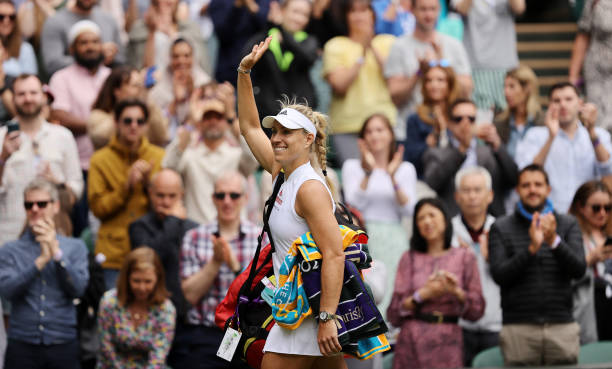 Angelique Kerber of Germany waves to the fans as she walks off the court after winning her Ladies' Singles Fourth Round match against Coco Gauff of...