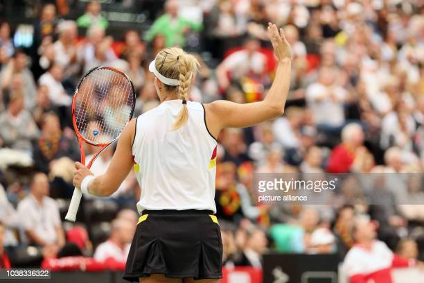 Angelique Kerber of Germany waves to the spectators after the match against Belinda Bencic of Switzerland at the Fed Cup tennis quarterfinal in...