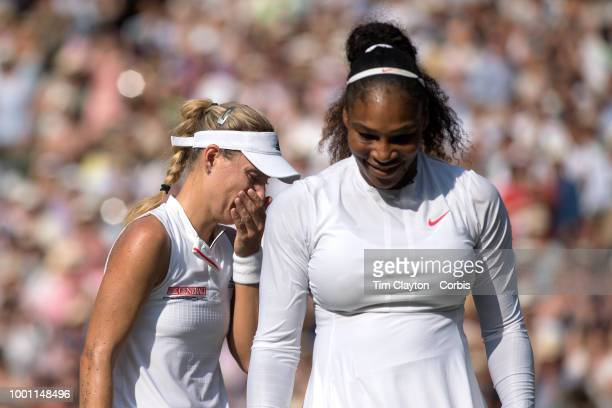 Angelique Kerber of Germany with Serena Williams of the United States after her victory in the Ladies' Singles Final on Center Court during the...
