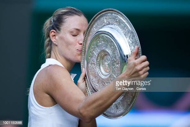 Angelique Kerber of Germany with the trophy after her victory against Serena Williams of the United States in the Ladies' Singles Final on Center...