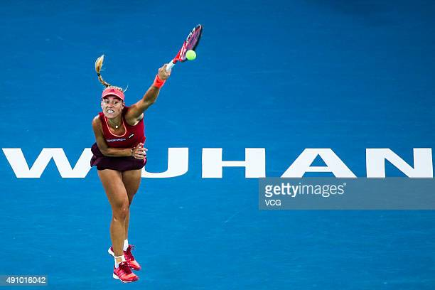 Angelique Kerber of Russia returns a shot against Garbine Muguruza of Spain in semifinal match during day six of 2015 Dongfeng Motor Wuhan Open at...