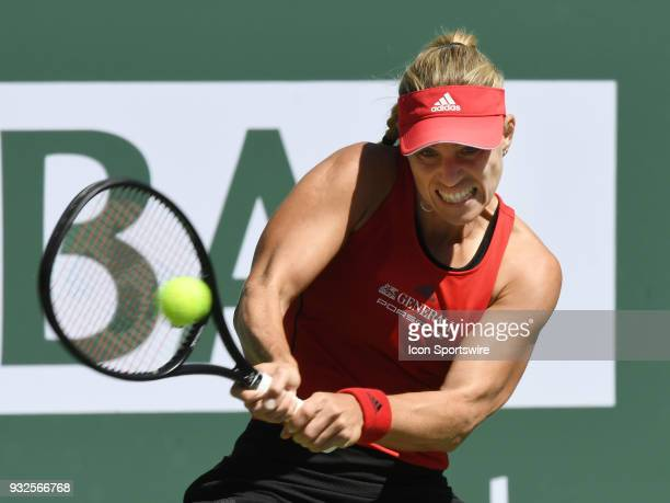 Angelique Kerber returns the ball during the second set of a quarterfinals match played during the BNP Paribas Open on March 15 2018 at the Indian...