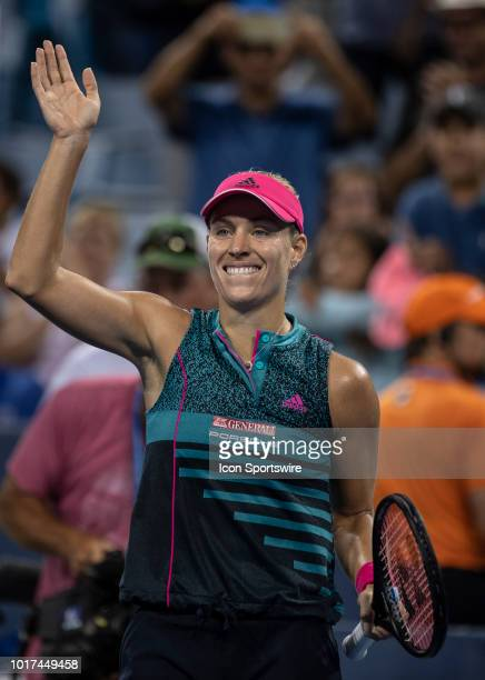 Angelique Kerber smiles after winning her match against Anastasia Pavlyuchenkova during Day 4 of the Western and Southern Open at the Lindner Family...