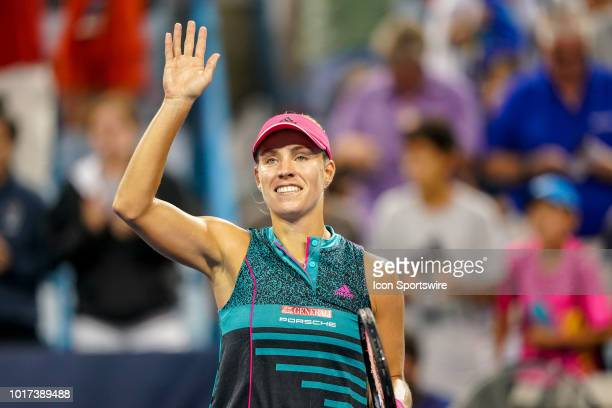 Angelique Kerber smiles and waves to the crowd after winning her game against Anastasia Pavlyuchenkova during the Western Southern Open at the...