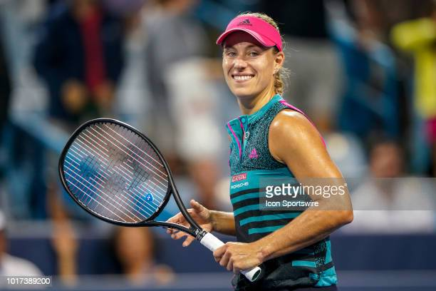 Angelique Kerber smiles at the crowd after winning her game against Anastasia Pavlyuchenkova during the Western Southern Open at the Lindner Family...
