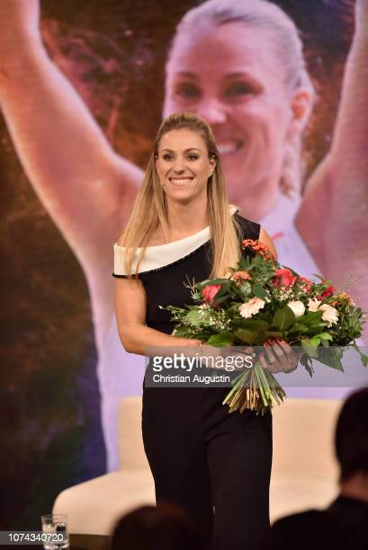 Angelique Kerber smiles on stage during the TV show 'Menschen 2018 - der ZDF Jahresrueckblick' at Phoenixhof on December 17, 2018 in Hamburg, Germany.