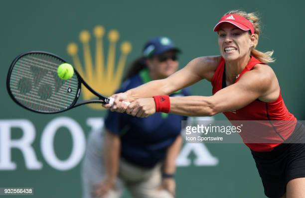 Angelique Kerber stretches to hit the ball during the second set of a quarterfinals match played during the BNP Paribas Open on March 15 2018 at the...