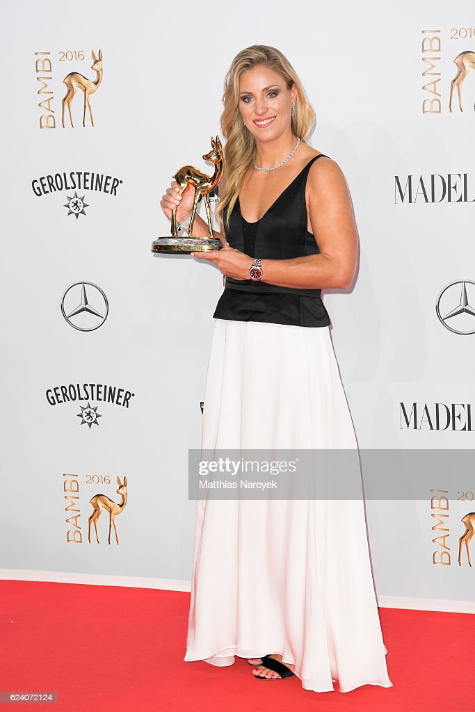 Angelique Kerber, wearing Tiffany, poses with award at the Bambi Awards 2016 winners board at Stage Theater on November 17, 2016 in Berlin, Germany.