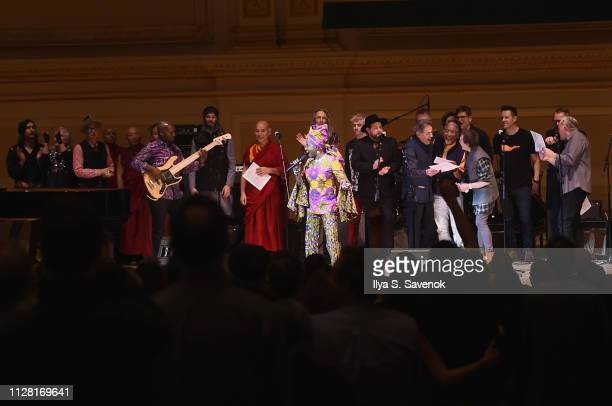Angelique Kidjo leads the finale performance on stage during 32nd Annual Tibet House US Benefit Concert Gala at Carnegie Hall on February 07 2019 in...