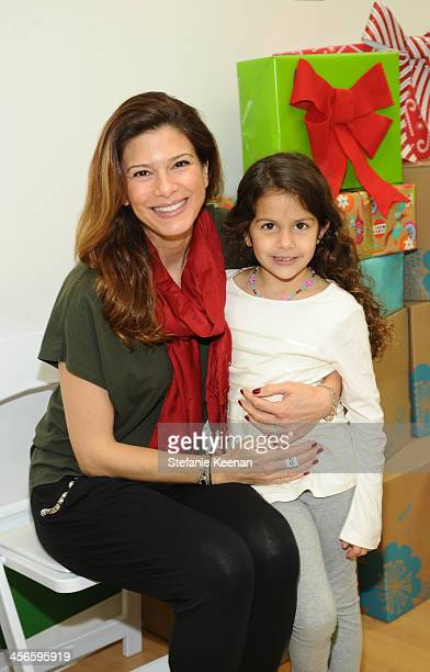 Angelique Madrid and Skylar DeLuca attend the Third Annual Baby2Baby Holiday Party presented by The Honest Company on December 14 2013 in Los Angeles...