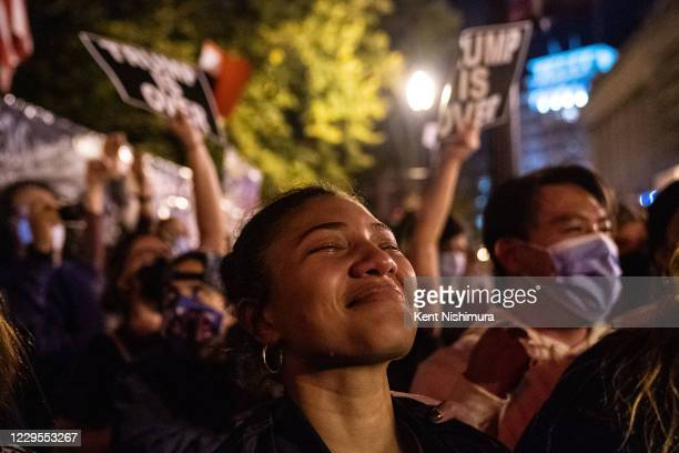 Angelique McKenna of Arlington, gets emotional listening to President-elect Joe Biden's speech, played over a loudspeaker at Black Lives Matter Plaza...