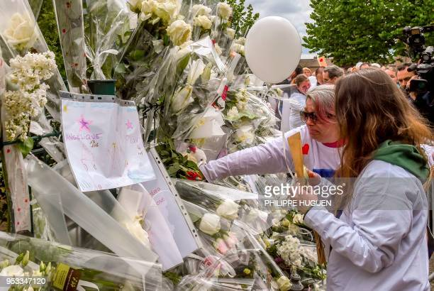 Angelique's sister and mother lay flowers during a march in Wambrechies northern France on May 1 in tribute to Angelique a 13yearold girl who was...
