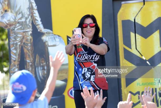 Angelle Sampey NHRA Pro Stock Motorcycle is introduced to the crowd during prerace festivities before the start of the NHRA AAA Midwest Nationals on...