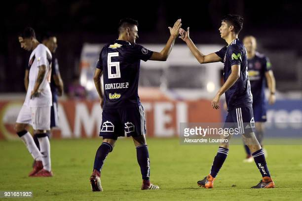 Angelo Araos of Universidad de Chile celebrates their first scored goal with Matias Rodriguez during a Group Stage match between Vasco and...