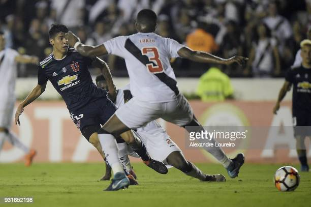 Angelo Araos of Universidad de Chile kicks the ball to score his goal during a Group Stage match between Vasco and Universidad de Chile as part of...