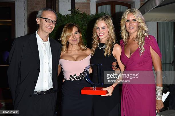 Angelo Ascoli Barbara D'Urso Irene Cioni and Tiziana Rocca attend 'Diva e Donna' Party during the 71st Venice Film Fetival at Centurion Palace Hotel...