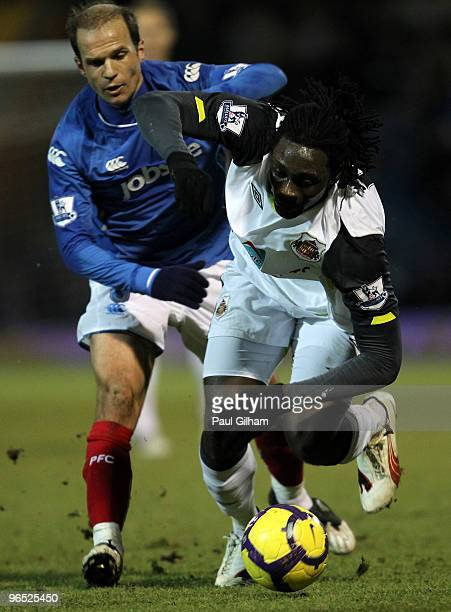 Angelo Basinas of Portsmouth battles for the ball with Kenwyne Jones of Sunderland during the Barclays Premier League match between Portsmouth and...