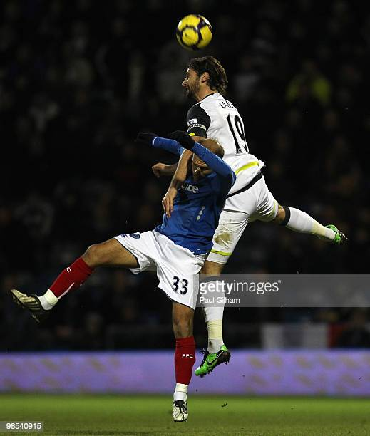Angelo Basinas of Portsmouth battles for the ball with Lorik Cana of Sunderland during the Barclays Premier League match between Portsmouth and...