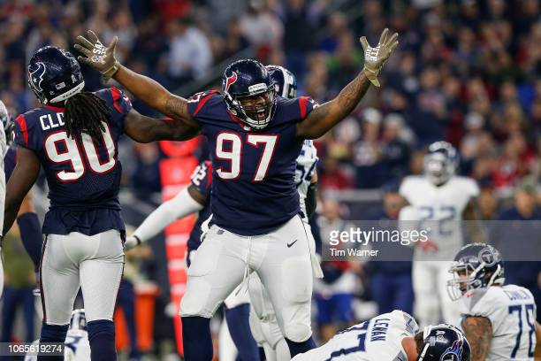 Angelo Blackson of the Houston Texans celebrates after a sack in the third quarter against the Tennessee Titans at NRG Stadium on November 26 2018 in...