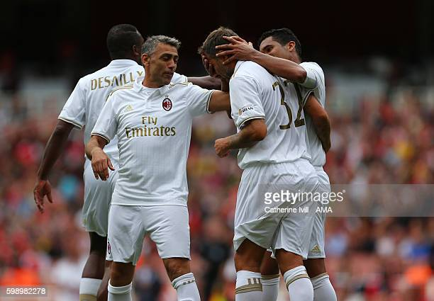 Angelo Carbone of Milan Glorie congratulates Christian Vieri of Milan Glorie after he scores during the Arsenal Foundation Charity match between...