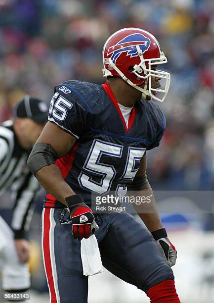 Angelo Crowell of the Buffalo Bills stands on the field during the game with the New England Patriots on December 11 2005 at Ralph Wilson Stadium in...