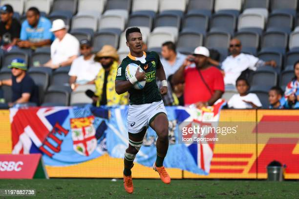 Angelo Davids of South Africa runs to score a try during Pool B, Match 12 between France and South Africa at the HSBC Sydney Sevens Rugby on February...