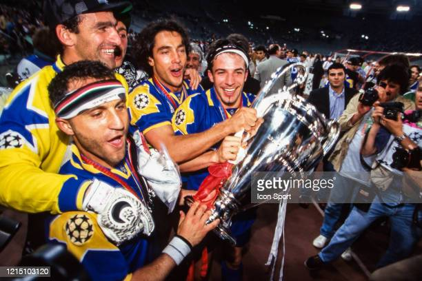 Angelo DI LIVIO Michelangelo RAMPULLA Paulo SOUSA and Alessandro DEL PIERO of Juventus celebrate the victory with the trophy during the Champions...