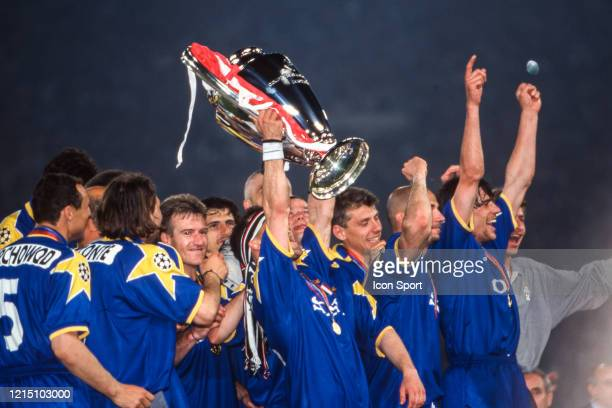 Angelo DI LIVIO of Juventus celebrate the victory with the trophy during the Champions League Final match between Ajax Amsterdam and Juventus Turin...