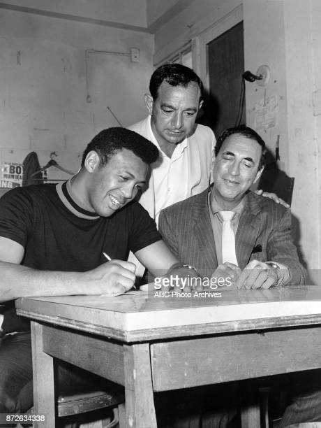 Angelo Dundee Jimmy Ellis Harold Conrad at signing