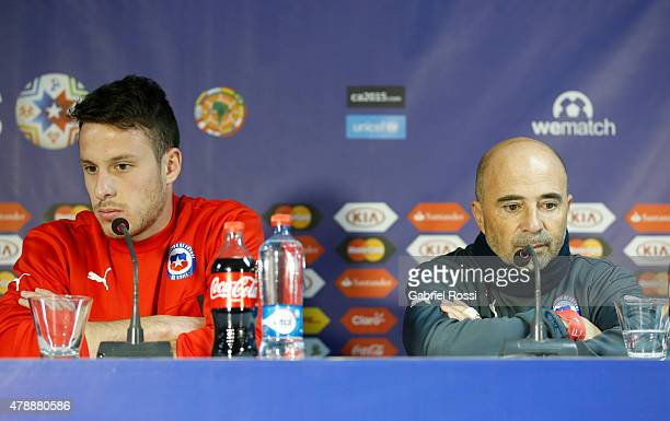 Angelo Enriquez of Chile and coach of Chile Jorge Sampaoli look on during a press conference prior to the semi final match against Peru at Nacional...