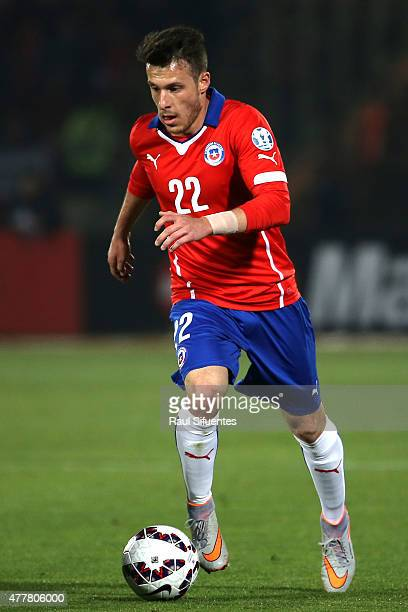 Angelo Enriquez of Chile drives the ball during the 2015 Copa America Chile Group A match between Chile and Bolivia at Nacional Stadium on June 19...