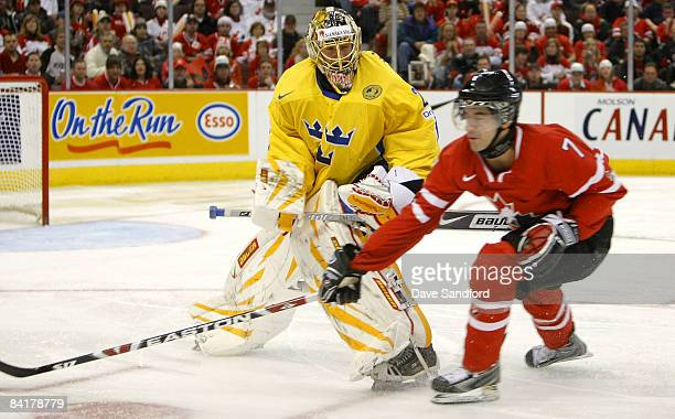 Angelo Esposito of Team Canada battles for the puck with Chris Di Domenico of Team Sweden during the 2009 IIHF World Junior Championships held at...