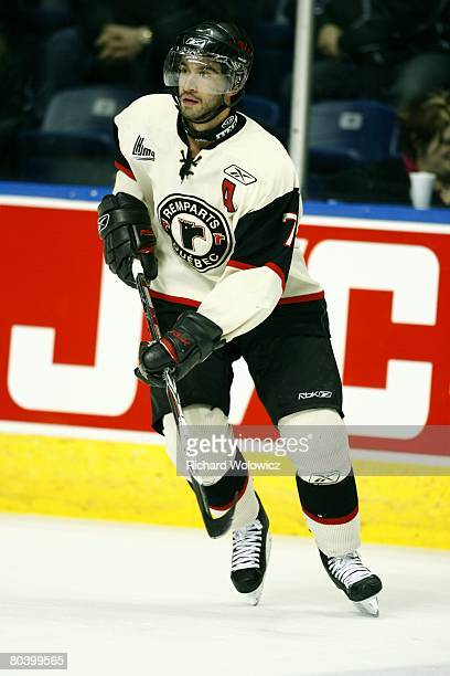 Angelo Esposito of the Quebec City Remparts skates during the warm up session prior to facing the Chicoutimi Sagueneens at Colisee Pepsi on March 26,...