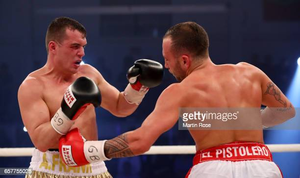 Angelo Frank of Germany and Denis Ilbay of Germany exchange punches during their GBU welterweight title fight at MBS Arena on March 25 2017 in...